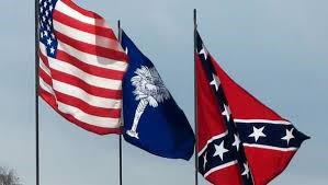Three flags of South Carolina U.S.A. - State – Confederacy Proudly unfurled atop the capital dome