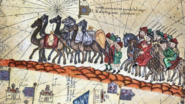 A medieval painting showing the 13th-century caravan of Niccolo Polo (father of Marco Polo) and Maffeo Polo (uncle of Marco Polo) crossing Asia. Detail of the Carta Catalana (1375). --- Image by © Bettmann/CORBIS