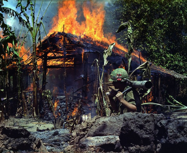 my_tho_vietnam-_a_viet_cong_base_camp_being-_in_the_foreground_is_private_first_class_raymond_rumpa_st_paul_minnesota_-_nara_-_530621_edit